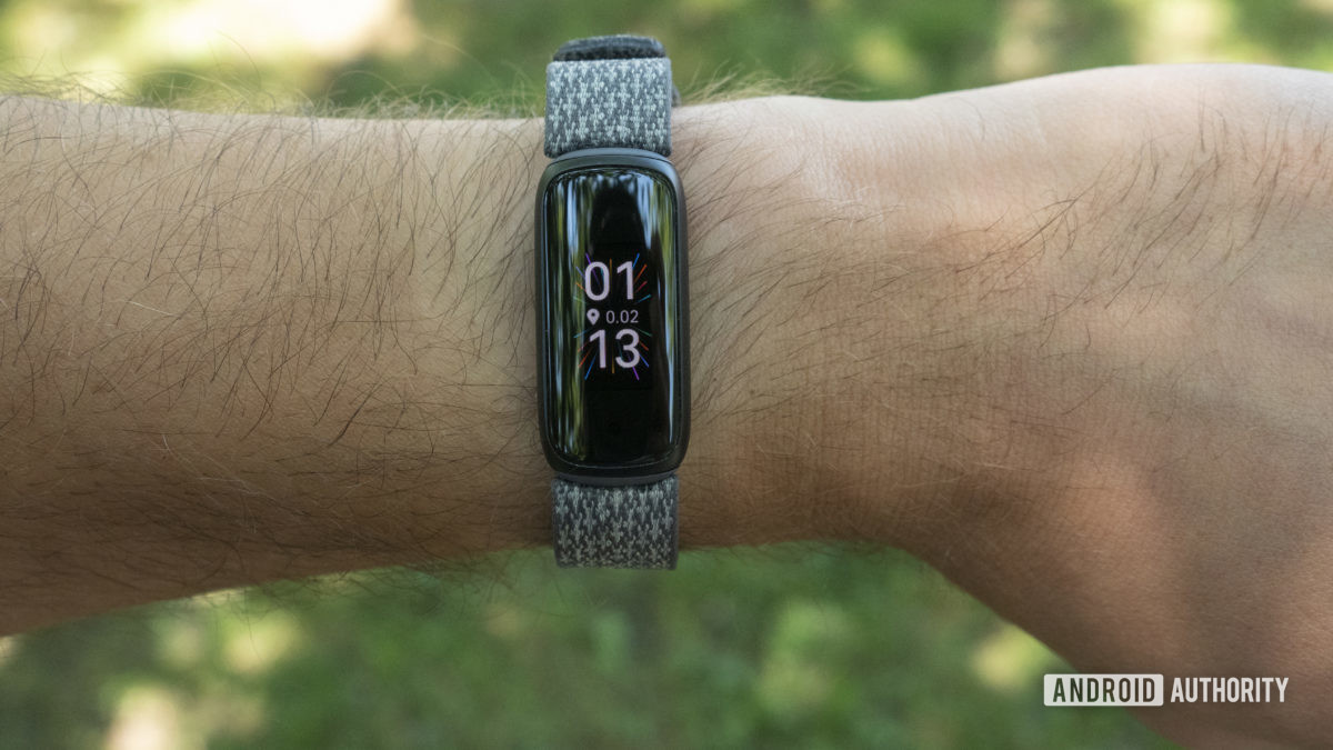 fitbit luxe review on wrist watch face slate woven strap