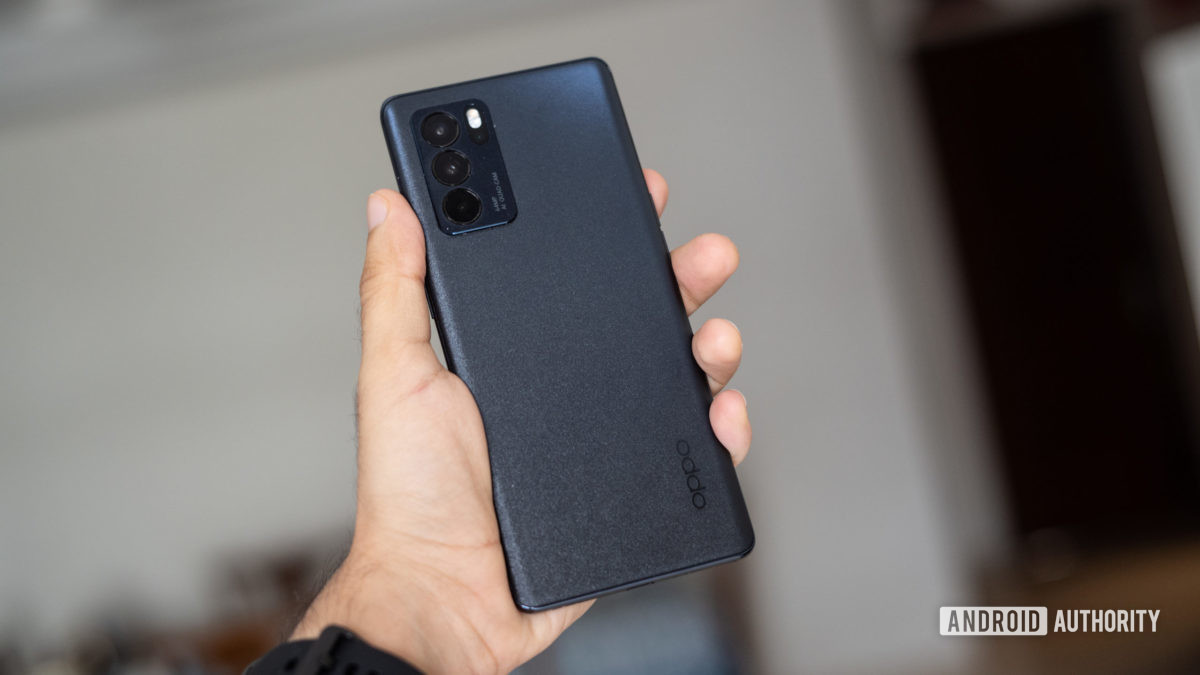 The Oppo Reno 6 Pro in hand showing the back and camera module.