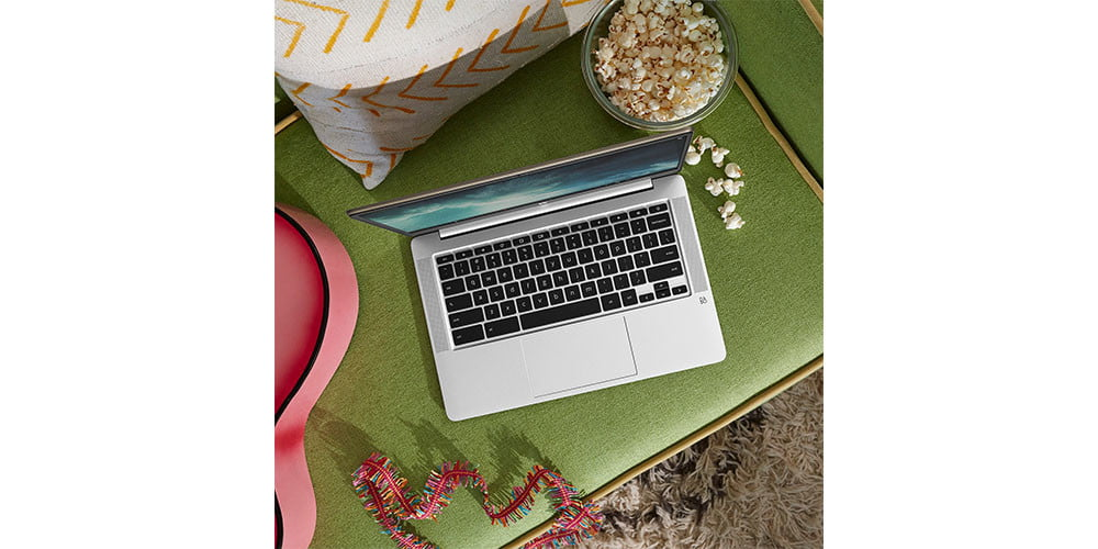 Lifestyle shot of HP Chromebook on a green desk.