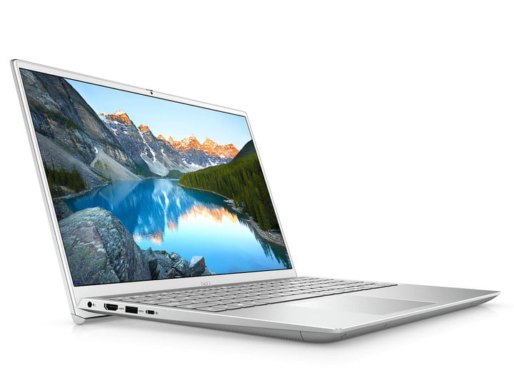 A silver Dell Inspiron 15 Plus laptop with a nature photo on the screen.