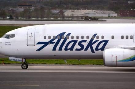 Smartphone fire on Alaska Airlines passenger jet prompts evacuation