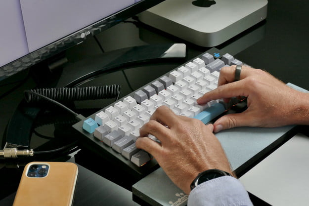 Typing on the Keychron Q1 mechanical keyboard.