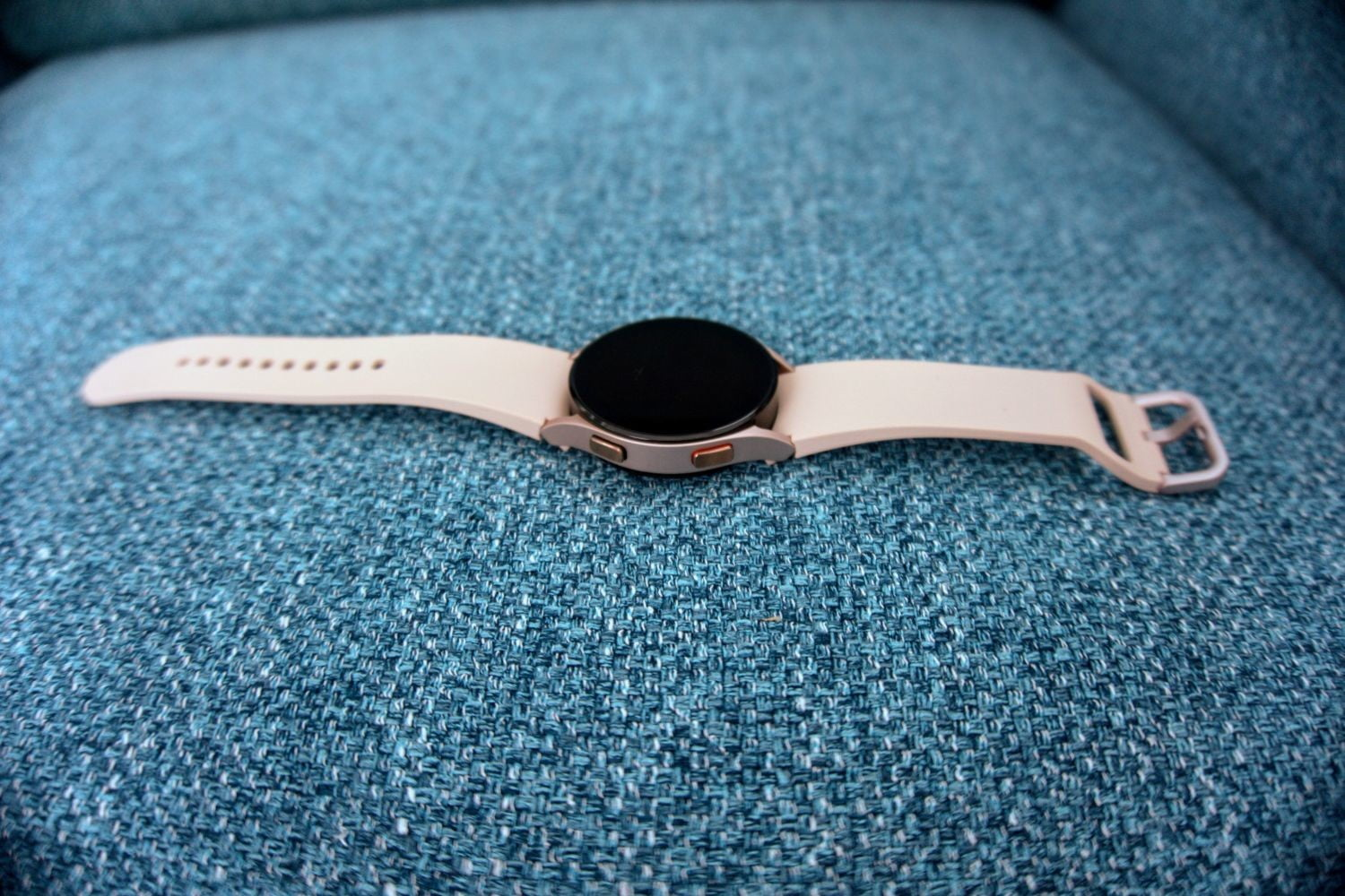 Watch 4 showing side buttons.