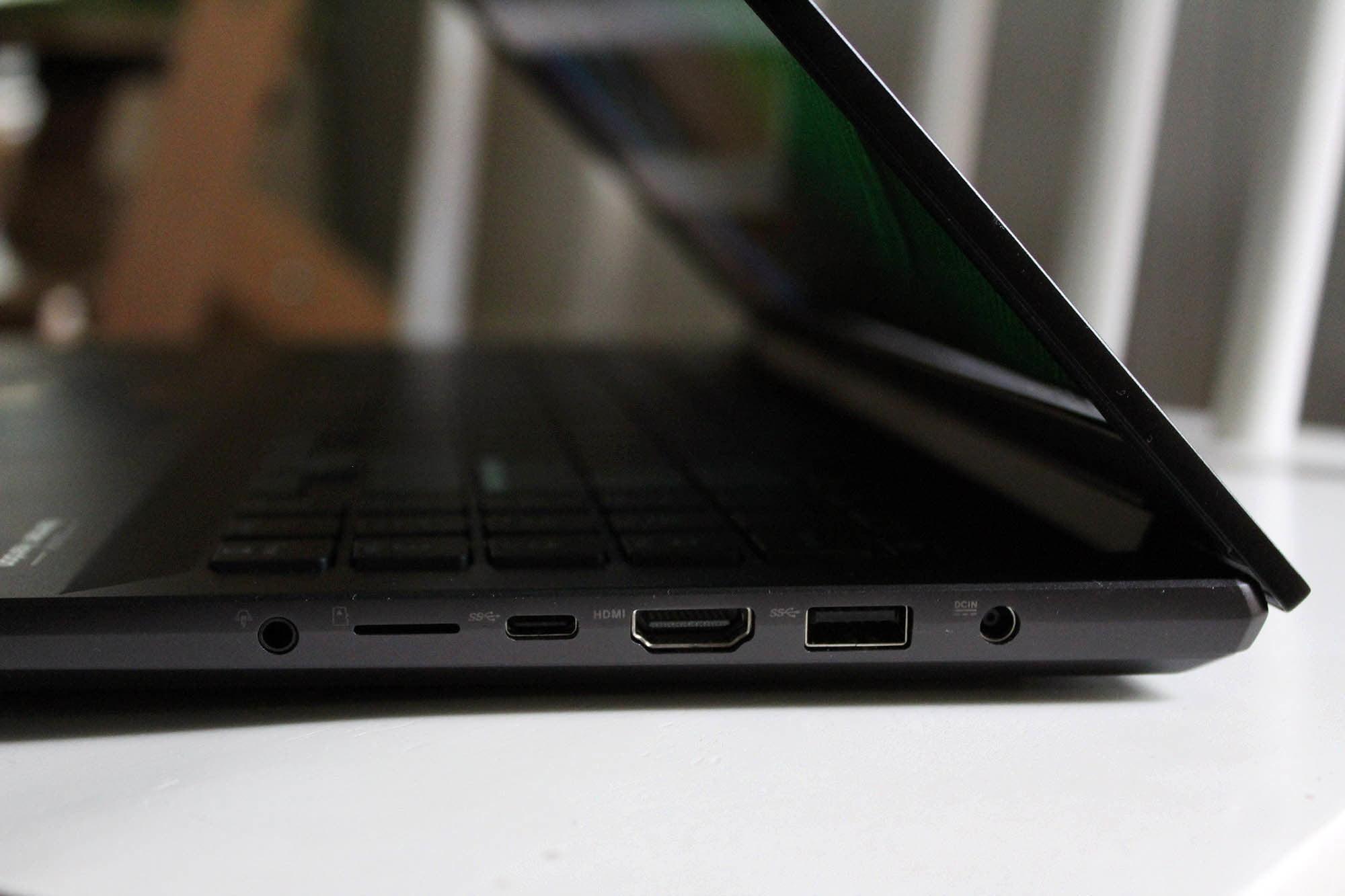 Right side connectivity on the Asus Vivobook Pro 16X OLED laptop. Headphone jack, micro SD slot, micro USB port, HDMI port, USB
