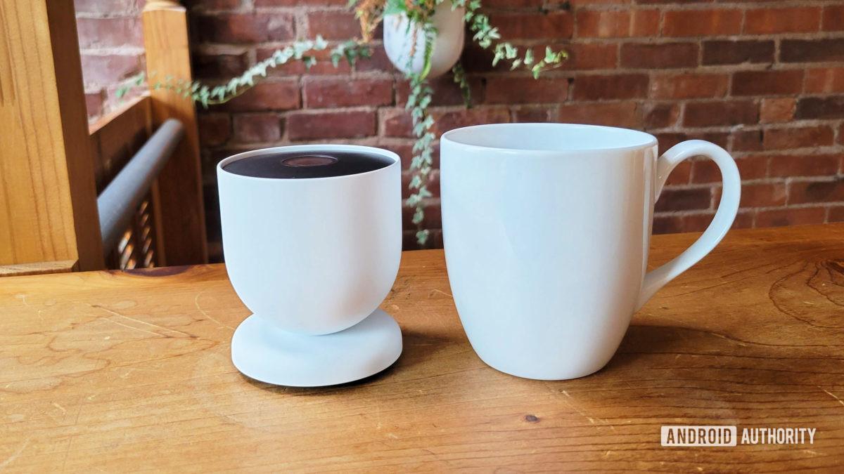 Google Nest Cam Review 2021 Next To Coffee Mug
