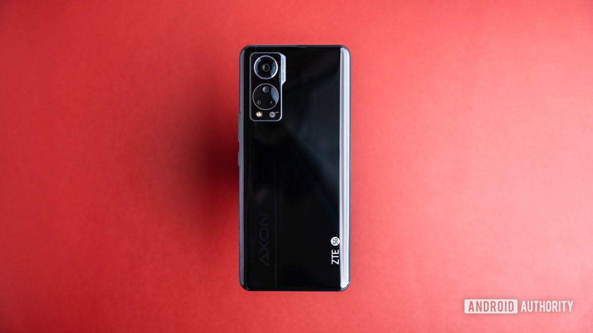 ZTE Axon 30 sitting on red table