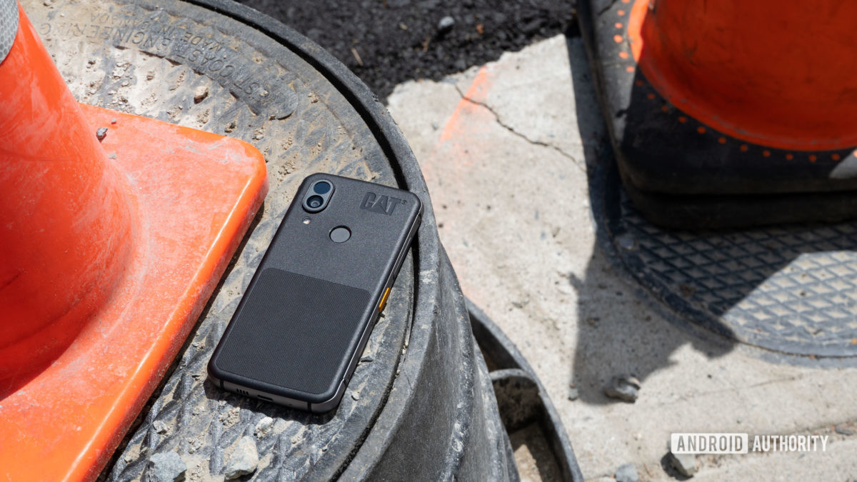 Cat S62 Pro outside next to a traffic cone.