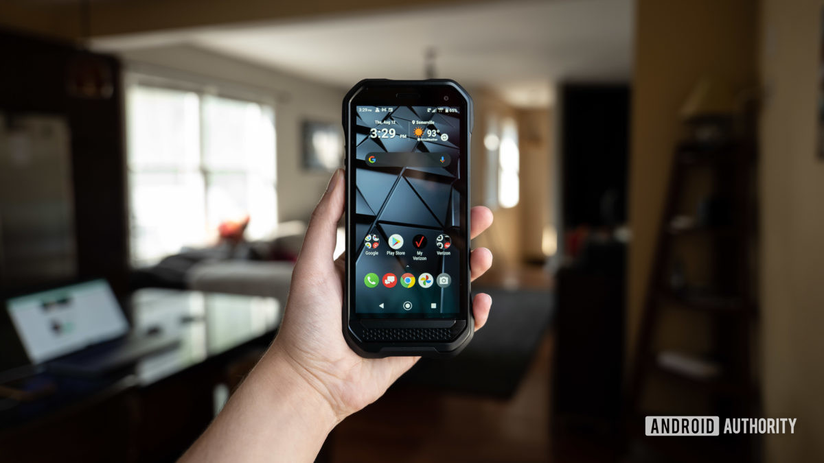 Kyocera Duraforce Ultra held in hand showing the screen.