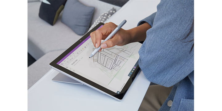A close-up of someone using the Microsoft Surface pro 7 in tablet mode.